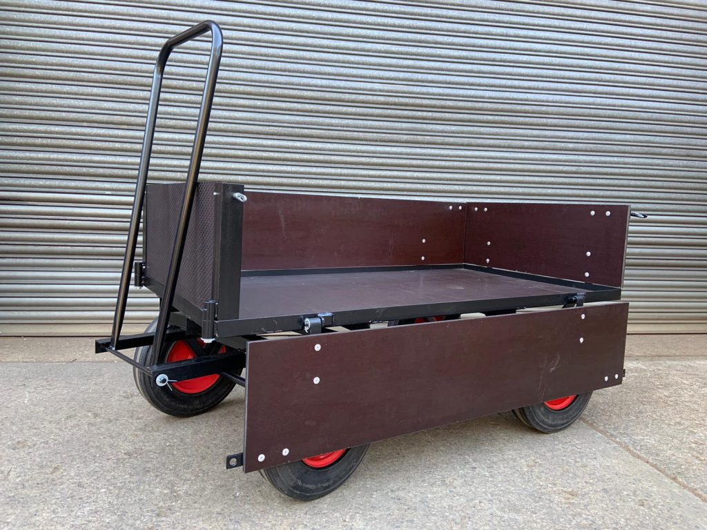 Hinged sided turntable truck